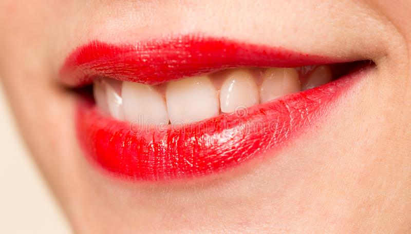 Beautiful smile with red lips stock image