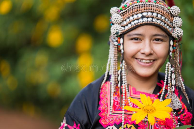Beautiful smile young hill tribe girl in sunflowers garden. royalty free stock photography