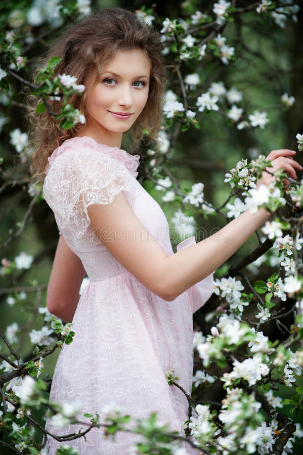 Beautiful smiley model in flowers royalty free stock photos