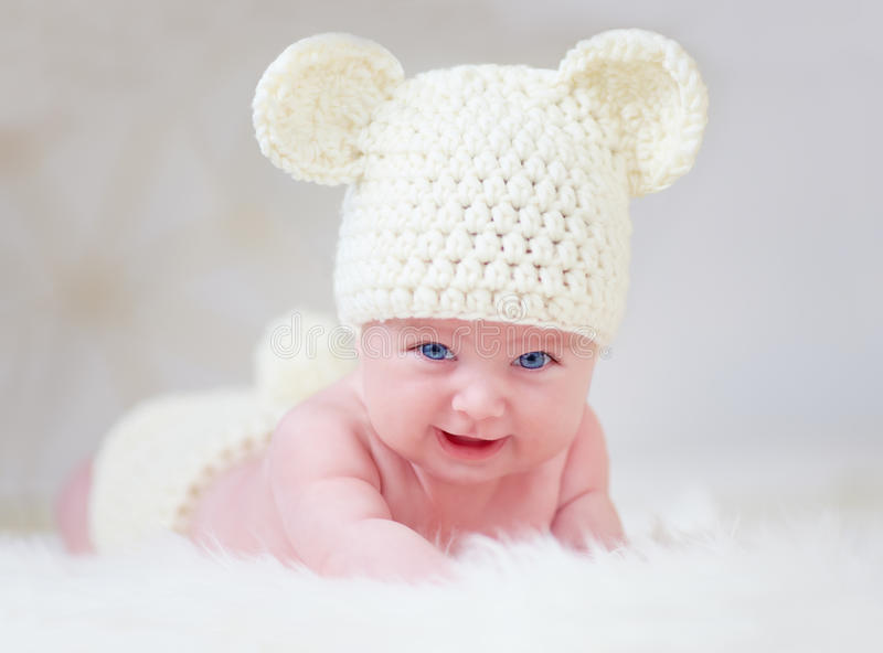 Beautiful smiling baby in cute hat royalty free stock image