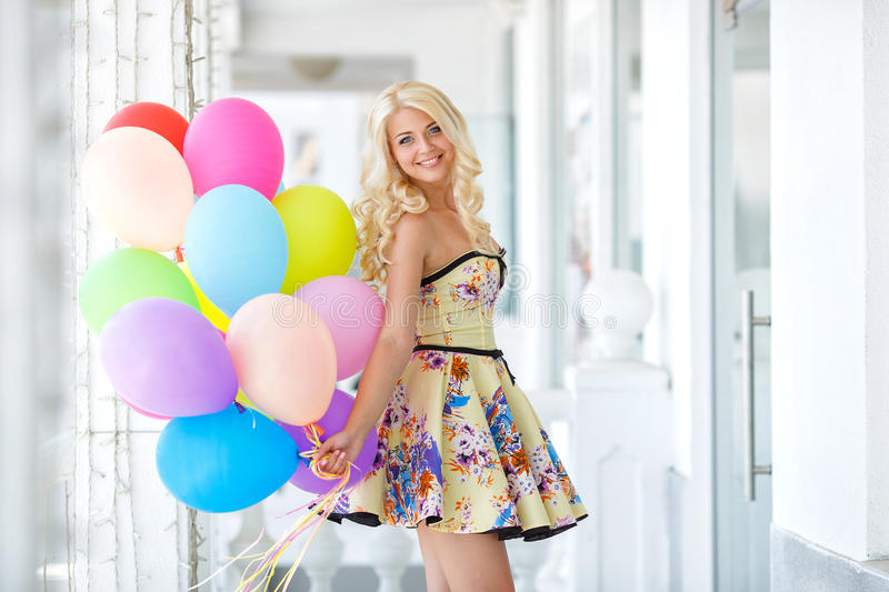 Download Beautiful Smiling Blond Girl With Colorful Balloons Stock Photo - Image of beautiful, outdoors: 41114390