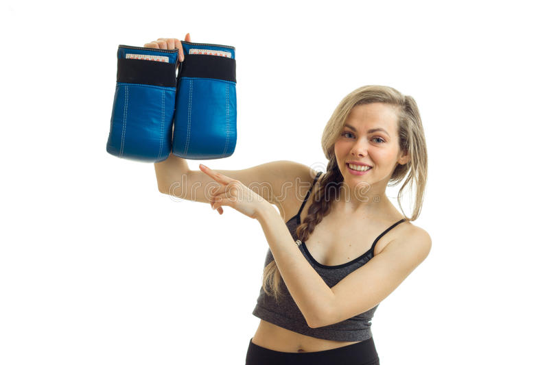 Beautiful smiling blonde looks into the camera and holds boxing gloves stock images