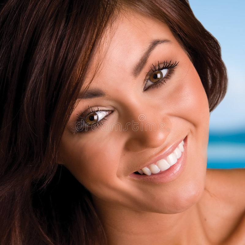 Beautiful smiling brunette royalty free stock photography