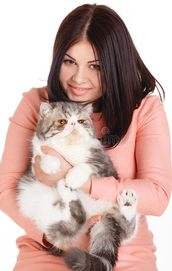 Beautiful Smiling Brunette Girl And Her Big Cat On A White Background Royalty Free Stock Photography