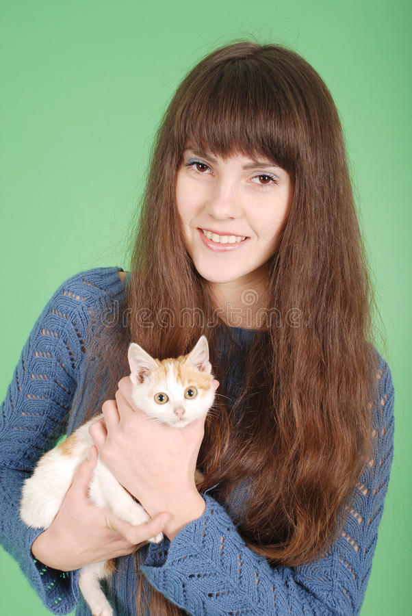 Beautiful smiling brunette girl and her cat royalty free stock images