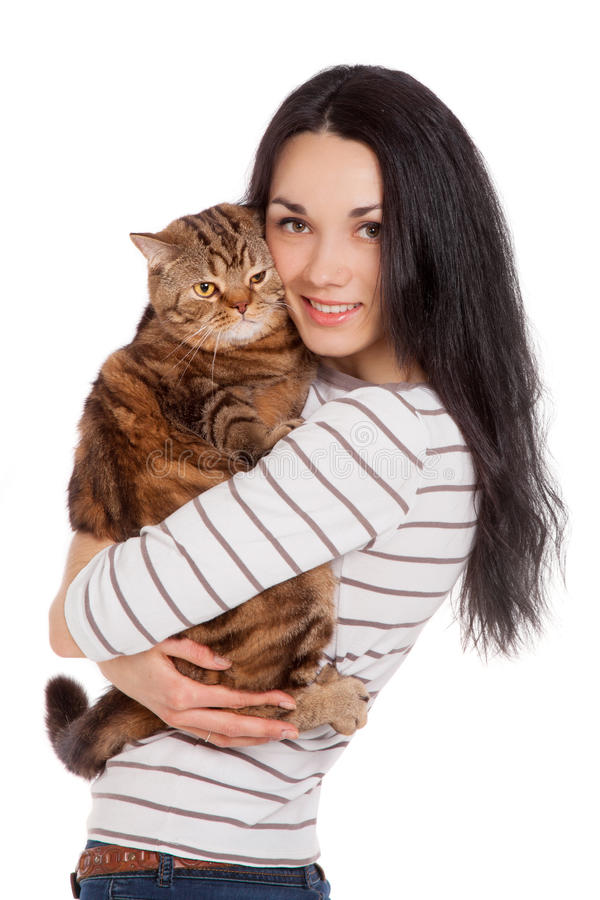 Beautiful smiling brunette girl and her ginger cat over white ba. Ckground royalty free stock photography