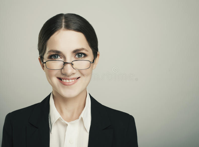 Beautiful smiling business woman on a dark background stock photos
