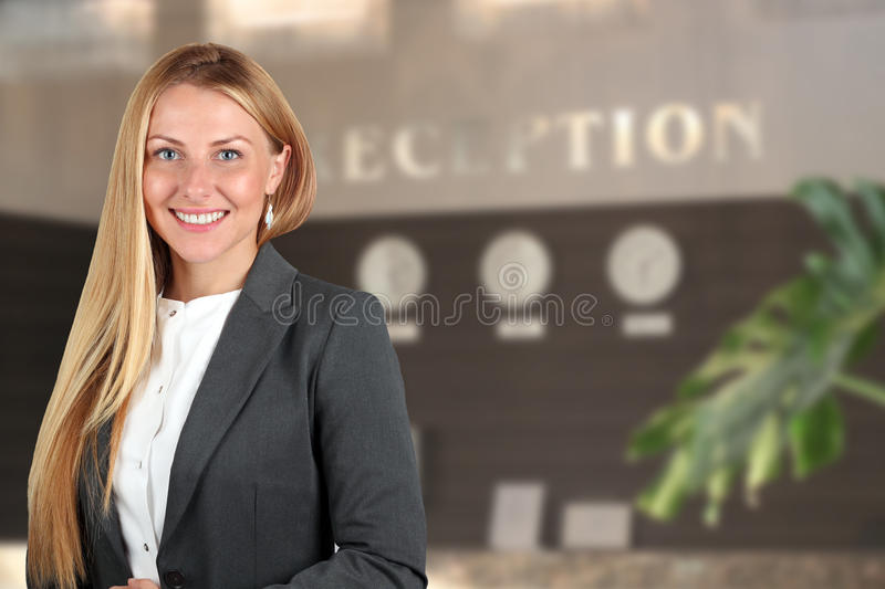 The Beautiful smiling business woman portrait. Smiling female receptionist. The Beautiful smiling businesswoman portrait. Smiling female receptionist royalty free stock images
