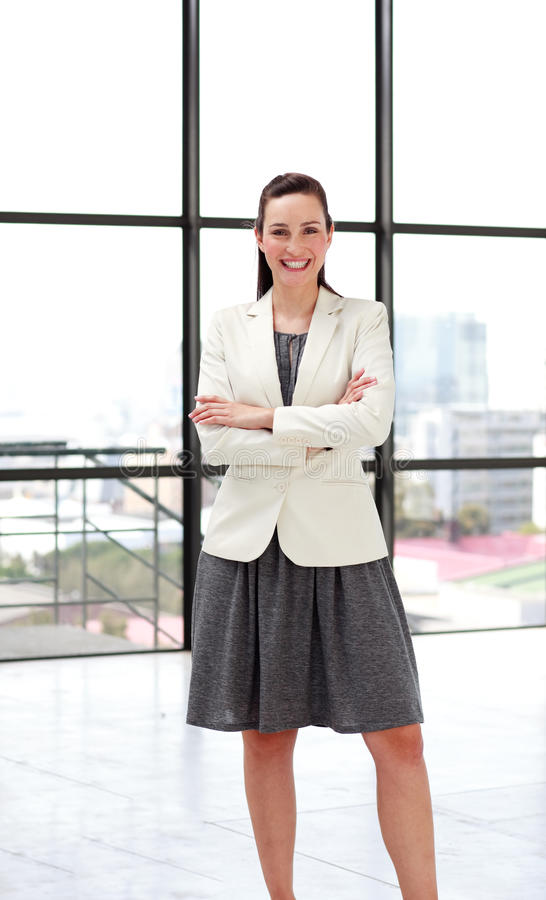Download Beautiful Smiling Businesswoman With Folded Arms Stock Photo - Image: 9758490