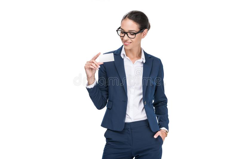 Beautiful smiling businesswoman holding empty business card,. Isolated on white stock photos