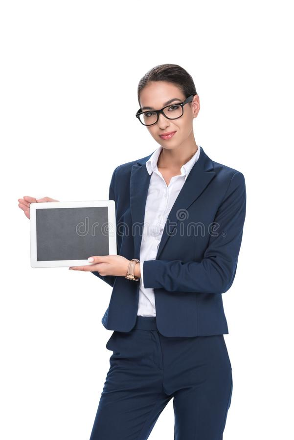 Beautiful smiling businesswoman presenting digital tablet with blank screen,. Isolated on white stock images