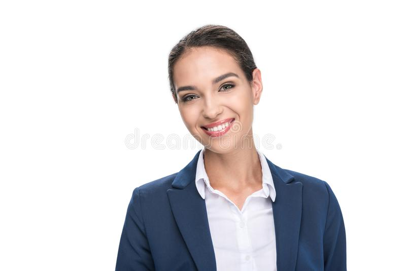 Beautiful smiling businesswoman in suit looking at camera,. Isolated on white royalty free stock photo