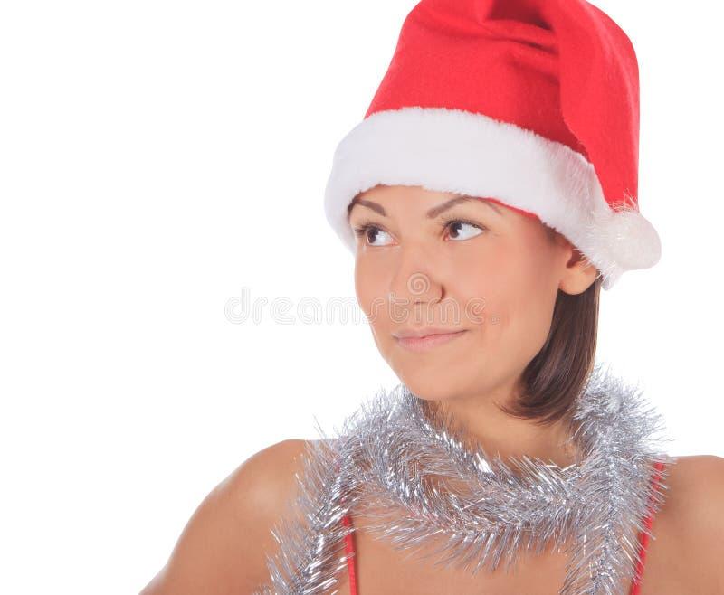 Beautiful smiling christmas santa woman stock photo