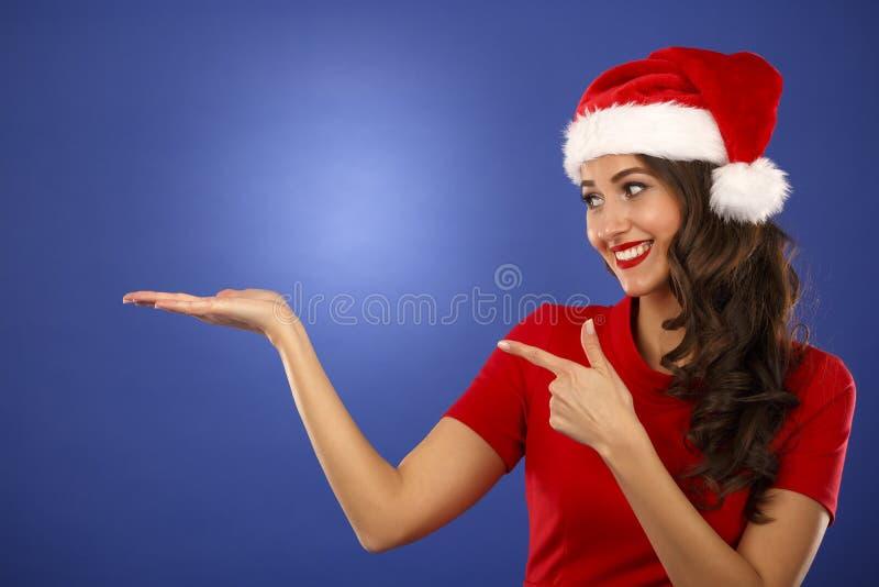 Beautiful smiling christmas santa woman pointing up showing copy royalty free stock photos