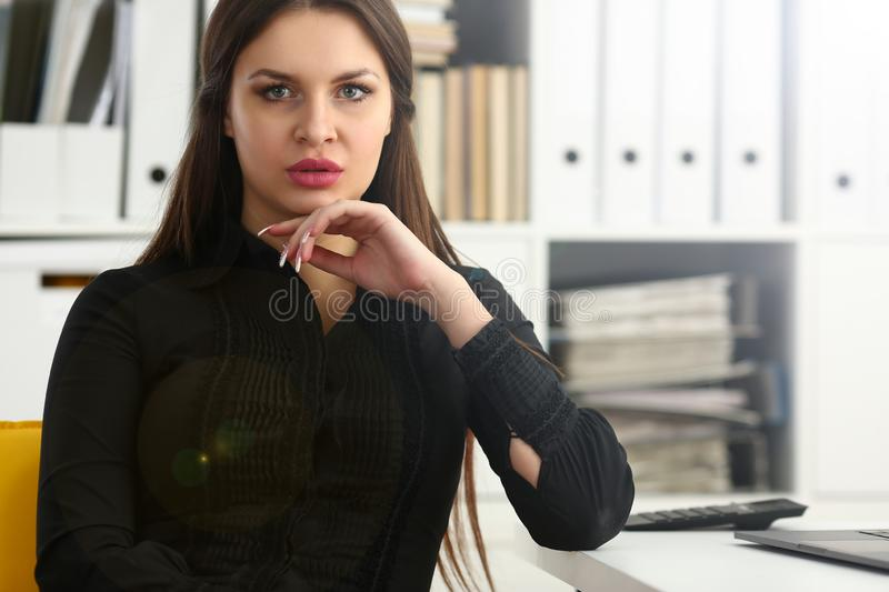 Beautiful smiling clerk girl at workplace talk to visitor. Looking in camera. White collar worker at workspace modern lifestyle client offer startup project irs stock photography