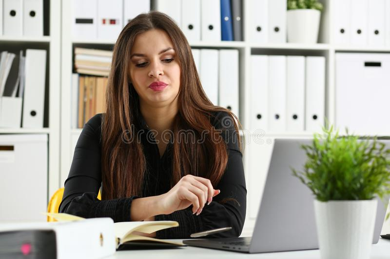 Beautiful smiling clerk girl at workplace talk to visitor. Looking in camera. White collar worker at workspace modern lifestyle client offer startup project irs royalty free stock image