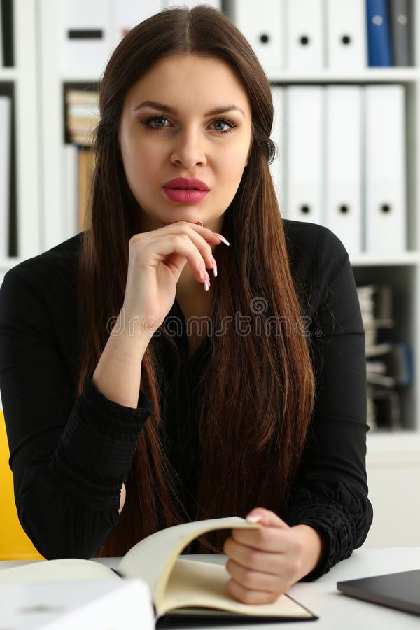 Beautiful smiling clerk girl at workplace talk to visitor. Looking in camera. White collar worker at workspace modern lifestyle client offer startup project irs stock image