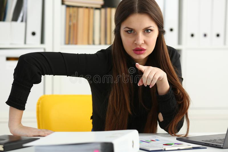 Beautiful smiling clerk girl at workplace talk to visitor. Looking in camera. White collar worker at workspace modern lifestyle client offer startup project irs stock photos