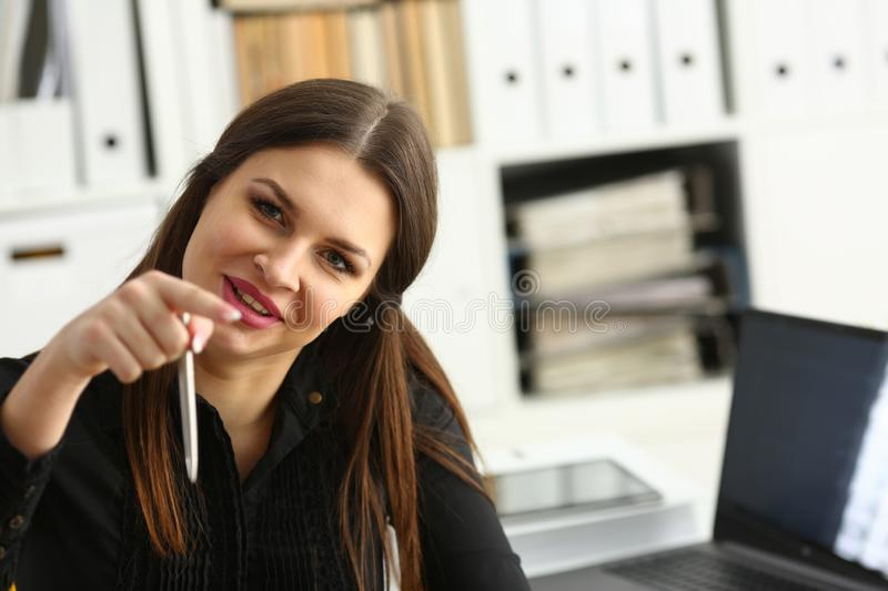 Beautiful smiling clerk girl at workplace talk to visitor. Looking in camera. White collar worker at workspace modern lifestyle client offer startup project irs royalty free stock photography