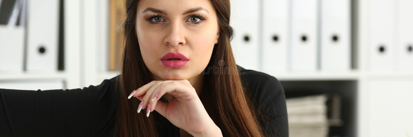 Beautiful smiling clerk girl at workplace talk to visitor. Looking in camera. White collar worker at workspace modern lifestyle client offer startup project irs royalty free stock photo