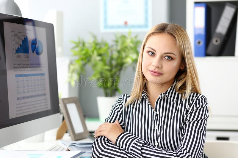 Beautiful smiling clerk looking in camera portrait stock photography