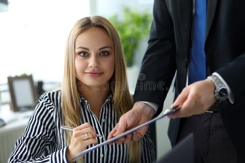 Beautiful smiling clerk looking in camera stock image