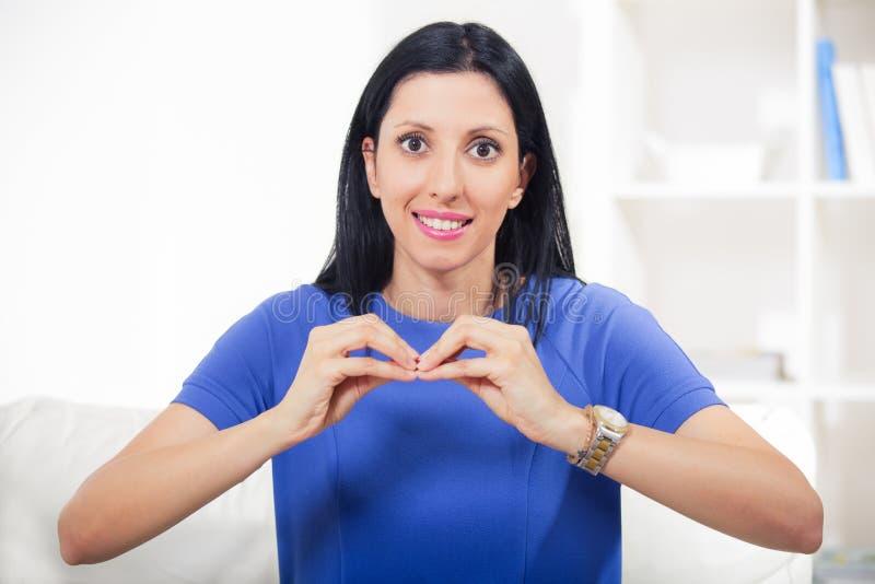 Beautiful smiling deaf woman using sign language. Smiling deaf woman using sign language royalty free stock photos