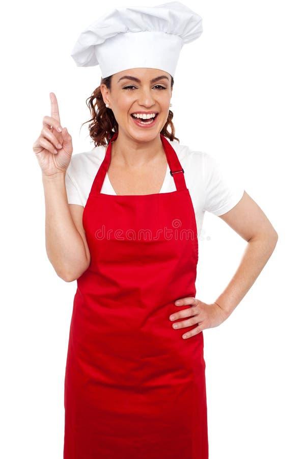 Download Beautiful Smiling Female Chef Indicating Upwards Stock Image - Image: 26395241