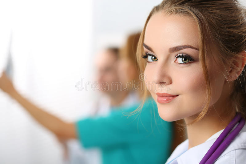 Beautiful smiling female medicine doctor looking in camera stock images