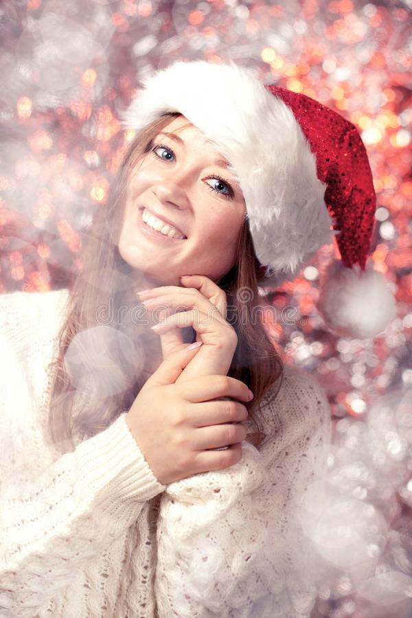Beautiful smiling female model wear santa hat stock images