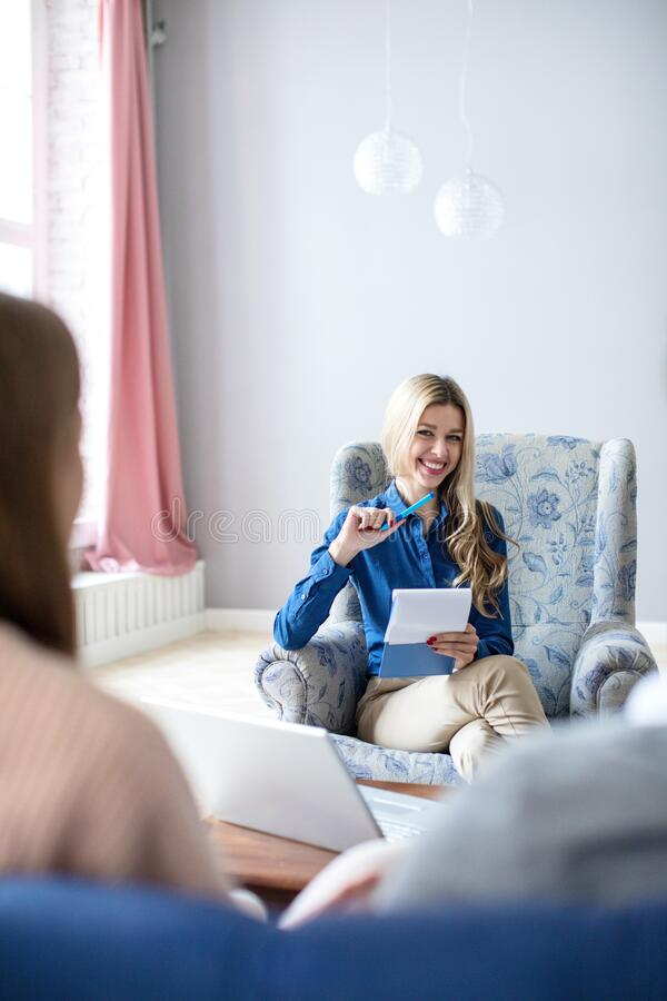 Beautiful smiling female psychologist conducting a consultation royalty free stock photography