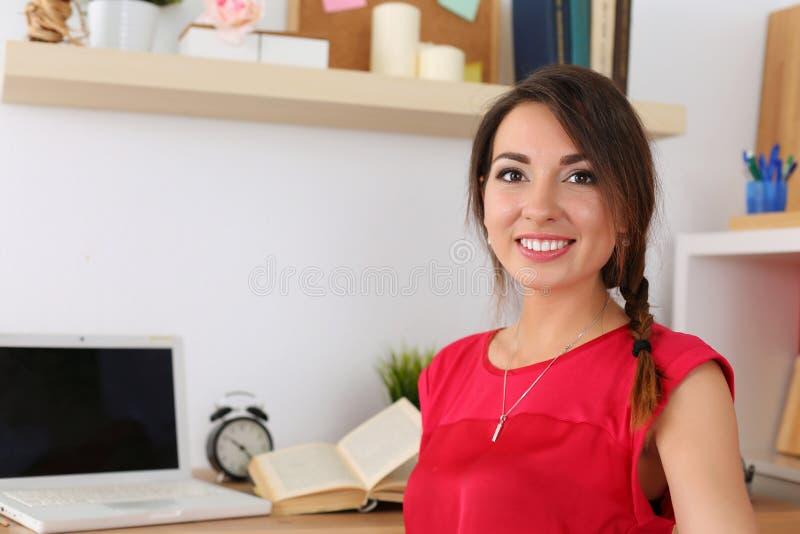 Beautiful smiling female student stock photos
