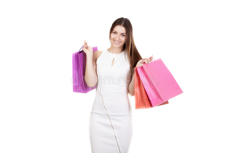 Beautiful smiling girl carrying colorful shopping bags. Smiling female holding colored shopping bags, copy space, isolated on white background. Concepts: sales royalty free stock photo