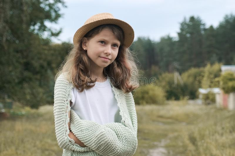 Beautiful smiling girl child in hat knitted blanket royalty free stock image