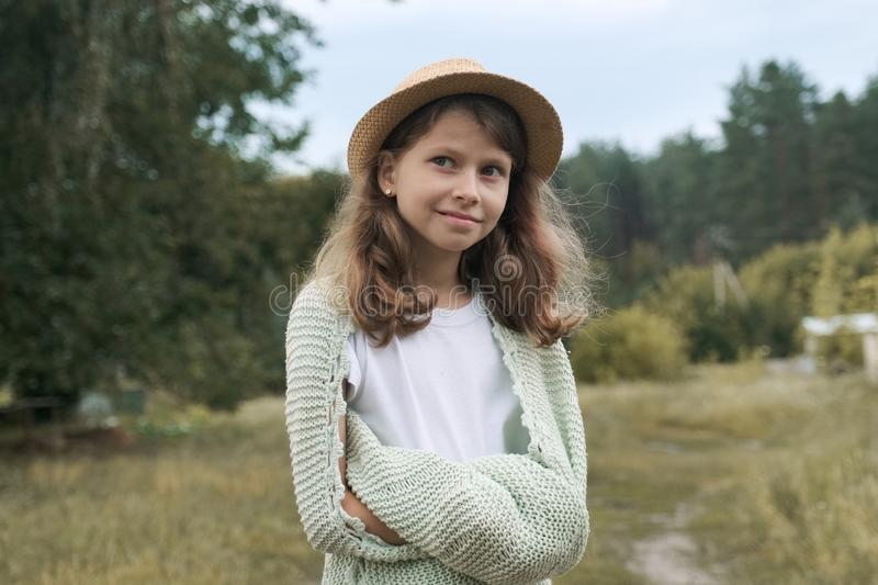 Beautiful smiling girl child in hat knitted blanket stock photo