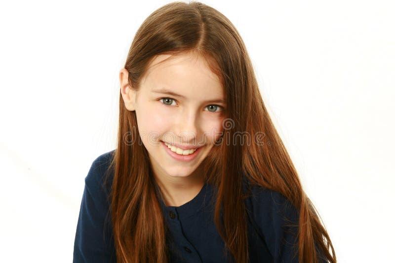 Beautiful smiling girl looking at camera stock image