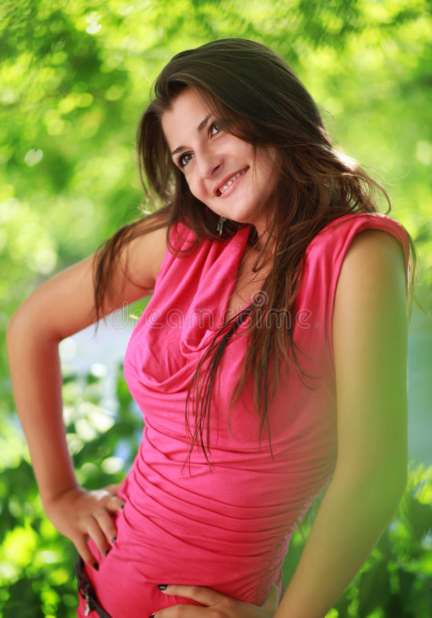 Beautiful smiling girl relaxing outdoor portrait royalty free stock photo