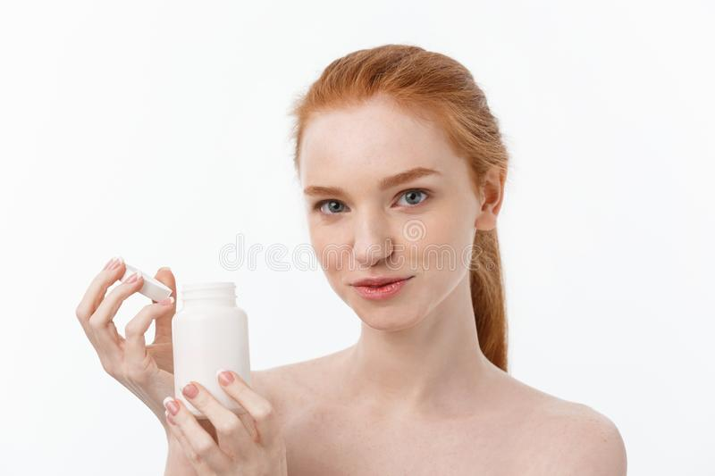 Beautiful Smiling Girl Taking Medication, Holding Bottle With Pills. Healthy Happy Female Eating Pill. Vitamins And royalty free stock image