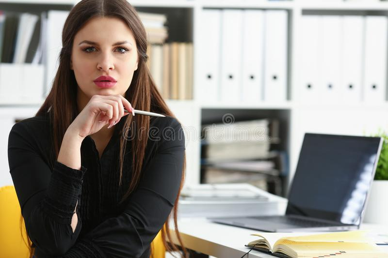 Beautiful smiling girl at workplace hold silver pen stock photos