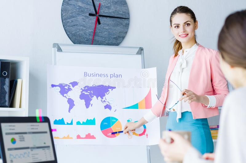 Confident business woman on business meeting at office royalty free stock photography