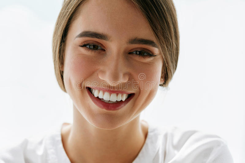 Beautiful Smiling Woman On White Background. Beauty Concept stock photos