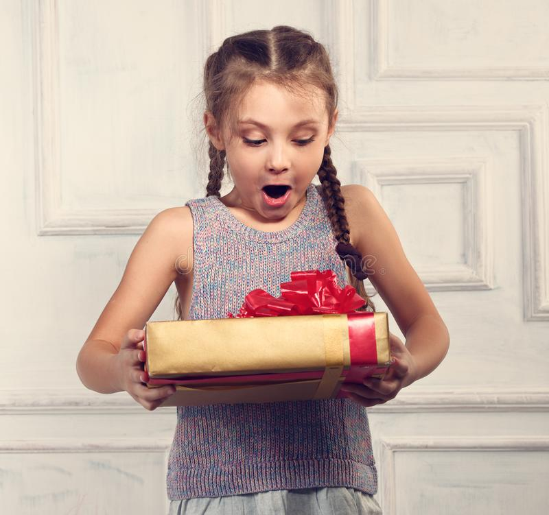 Beautiful smiling surprising cute girl with open mouth holding t royalty free stock photos