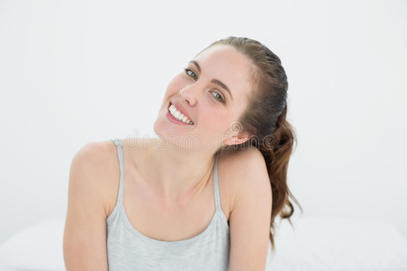 Beautiful smiling woman against the wall royalty free stock photo