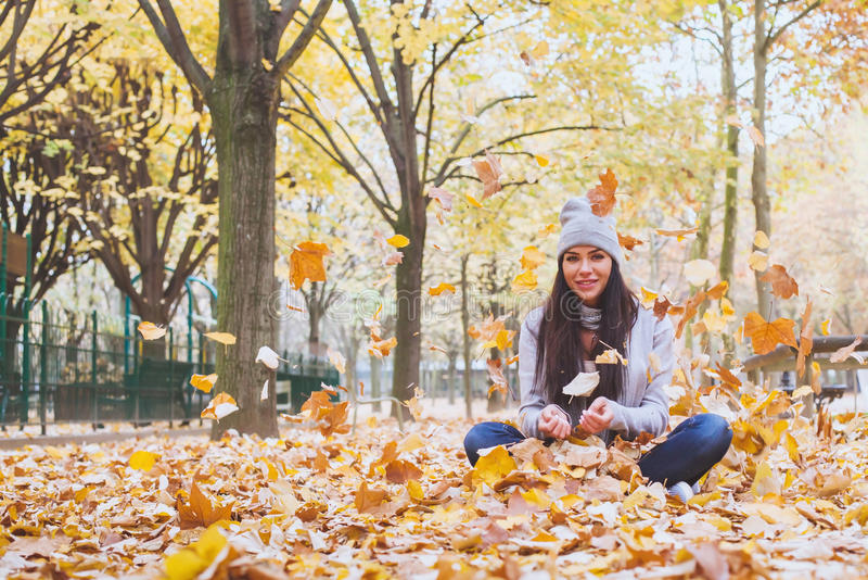 Beautiful smiling woman in autumn park stock photo
