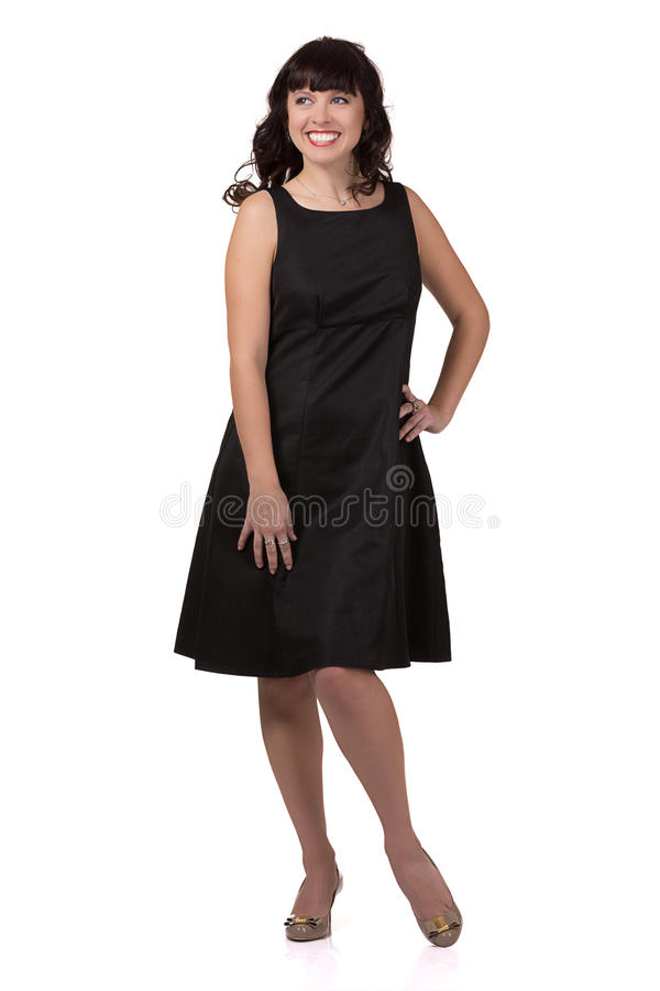 Beautiful smiling woman in a black dress. Beautiful smiling woman in a black dress on white background royalty free stock photography