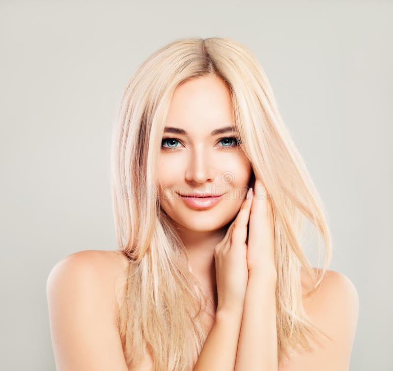 Beautiful Smiling Woman with Blonde Hair. Blondie Fashion Model stock photo