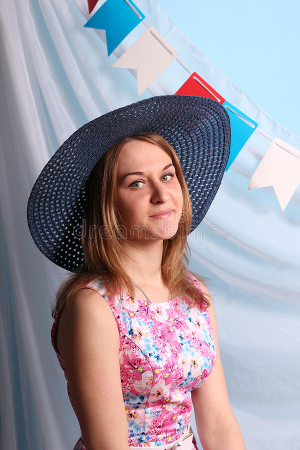 Beautiful smiling woman in blue hat poses stock photos
