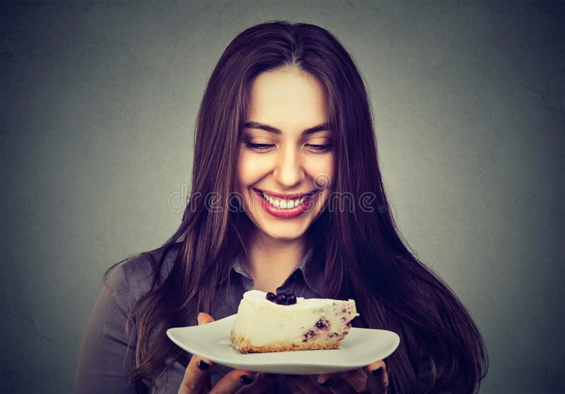 Beautiful smiling woman with a cake royalty free stock photo