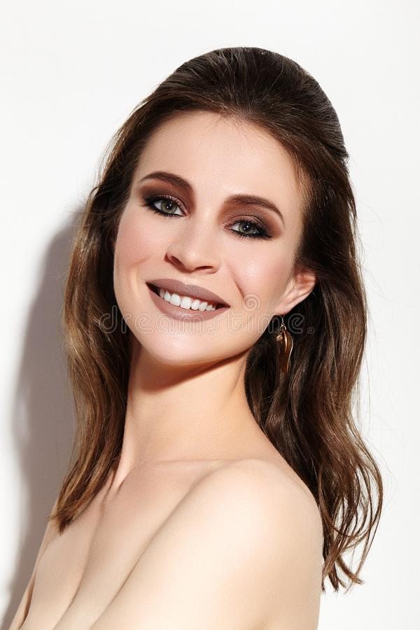 Beautiful Smiling Woman with Clean Skin, Celebrate Make-Up. Joyfull and Happiness. Christmas Party Fashion Look stock image