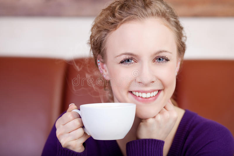 Beautiful smiling woman enjoying cup of coffee stock photos
